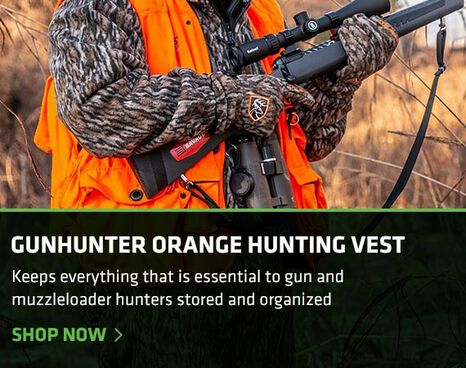 Hunter walking to a blind wearing a gun hunter's vest